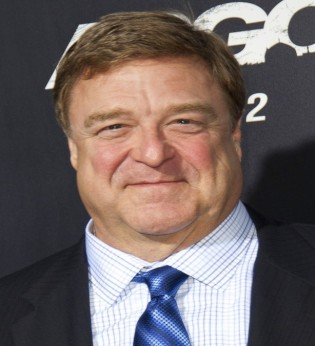 John Goodman as Desmond Cataliades