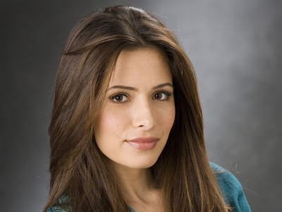 Sasha played by Sarah Shahi